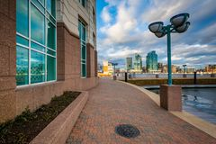 Walkway and the Harborview Tower, in Baltimore, Maryland.  stock images