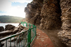 Walkway in high cliffs at seaside Stock Image