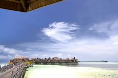 Walkway and Huts on Stilts Stock Photo