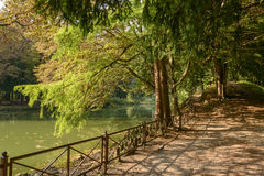 Walkway by lake in Villa Reale park, Monza, Italy Stock Images