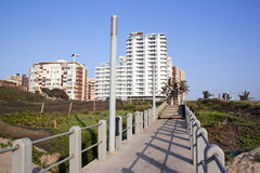 Walkway Leading from Beach with Residential Buildi Stock Images