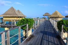 Walkway leading to over the water bungalows Royalty Free Stock Image