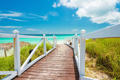 Walkway leading to a tropical beach in Cuba Royalty Free Stock Images
