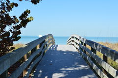 A walkway leads to the ocean Stock Photography