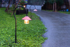Walkway lighting. Beautiful garden walkway lighting with lamps at night Royalty Free Stock Images