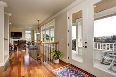 Walkway in luxury home with glass doors. Royalty Free Stock Images