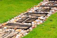 Walkway made from wood and gravel. Walkway made from old wood and gravel royalty free stock photo