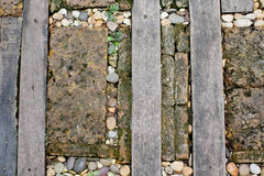 Walkway made old wood and stone on the grass Stock Image