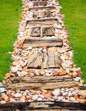 Walkway made ​​from wood and gravel Stock Photo
