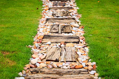 Walkway made from wood and gravel Stock Photos