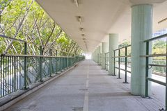 Walkway with a metal handrail. Stock Photography