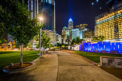 Walkway and modern buildings at night, seen at Romare Bearden Pa Stock Photos