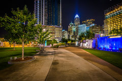 Walkway and modern buildings at night, seen at Romare Bearden Pa. Rk, in Uptown Charlotte, North Carolina Stock Images