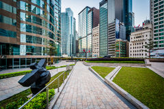 Walkway and modern skyscrapers at Central, in Hong Kong. Stock Photos