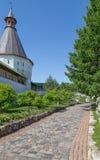Walkway in the monastery garden. Walkway in the garden of Novospassky monastery, Moscow, Russia Stock Images