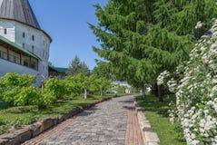 Walkway in the monastery garden. Walkway in the garden of Novospassky monastery, Moscow, Russia Stock Photos