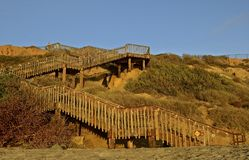 Walkway From Ocean Beach to Bluff Top. A series of steps begin at ocean side and lead to the top of a bluff Stock Image