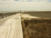 Walkway over dunes to beach Stock Photography