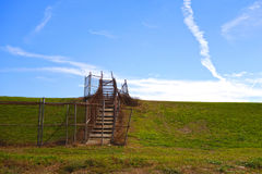 Walkway over Levee in New Orleans. Weathered stairway path over the berm of the levee to the Mississippi River in New Orleans Stock Image
