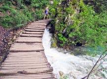 Walkway over the waterfall. stock photos