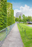 Walkway in the park with modern building. Walkway in the park with modern building landscape Royalty Free Stock Photo