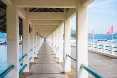 Walkway for passenger walking to embark to boat at harbor in Ran. Ong, Thailand stock photography