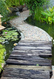 Walkway path. Over Lotus pond Stock Photo