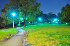 Walkway in a peaceful park, by night Royalty Free Stock Photo
