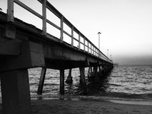 Walkway of the pier in black and white style Stock Images