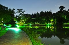 Walkway by the pond at night Stock Image
