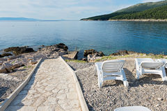 Walkway on the rocky beach in Istria Royalty Free Stock Images