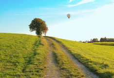 Walkway through rural landscape, hotair balloon Stock Photos