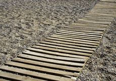 Walkway on a shingle beach Royalty Free Stock Photography
