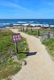 Walkway and sign for Asilomar State beach in Pacific Grove, Cali Royalty Free Stock Photo