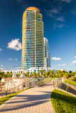 Walkway at South Pointe Park and skyscraper in Miami Beach, Florida. royalty free stock photo