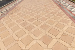Walkway with square stone tiles Royalty Free Stock Image