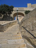Walkway and stairs in Malta. The stone walkway and stairs in Malta royalty free stock photography