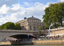 Walkway Stone wall along Siene River, Paris. Old Style building, Bridge Arch with Walkway and Stone wall along Siene River, Paris Stock Images