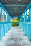The walkway and structure of blue iron bridge Stock Images