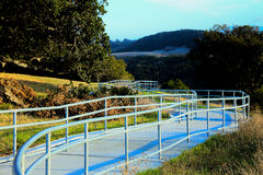 Walkway surrounded by trees going into distance. California scenic rest stop walkway with handrails to go to a overlook royalty free stock photo
