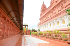 Walkway beside temple. Walkway beside Thai red Bodh Gaya in Thai Temple, Nakhonsawan, Thailand Royalty Free Stock Photos