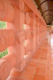 Walkway beside temple. Walkway beside Thai red Bodh Gaya in Thai Temple, Nakhonsawan, Thailand Royalty Free Stock Image