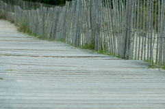 Walkway leading to the beach. A fenced wooden walkway leading to the beach Stock Photos