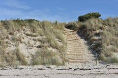 Walkway to beach over sand dune Stock Photo