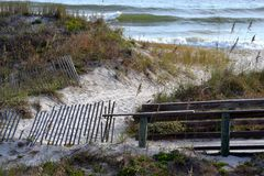 Walkway to the beach. A sandy walkway to the beach on a clear morning Royalty Free Stock Photos