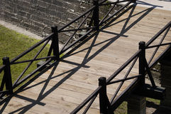 Walkway to fort over moat in St.Augustine, Florida. Wooden planked walkway over mote into fort in St.Augustine, Florida Royalty Free Stock Image