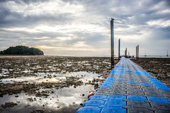 Walkway to harbor and view of seascape with sunrise at Railay Beach. Stock Photos