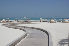 Walkway to idyllic beach with pure white sand Stock Photography