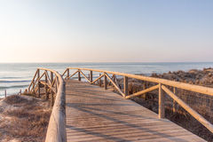 Walkway to Mediterranean beach Royalty Free Stock Photos