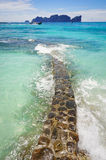 Walkway to the sea on beach side rocks Stock Photos